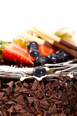 Fruit detail on a chocolate cake photo