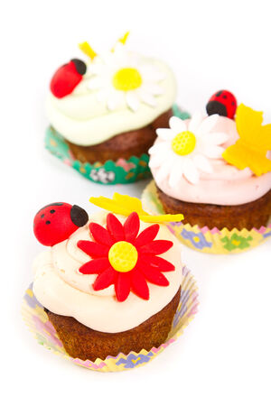Three cupcakes on white background photo