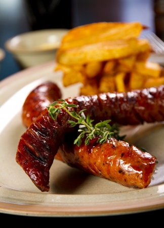 Grilled sausage with French fries photo