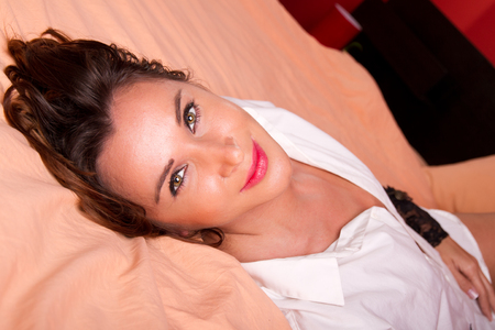 Portrait of a beautiful woman lying in bed photo