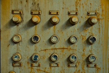 Old control panel in an abandoned factory photo