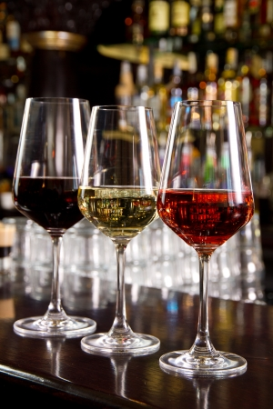 Three glasses of wine on the counter