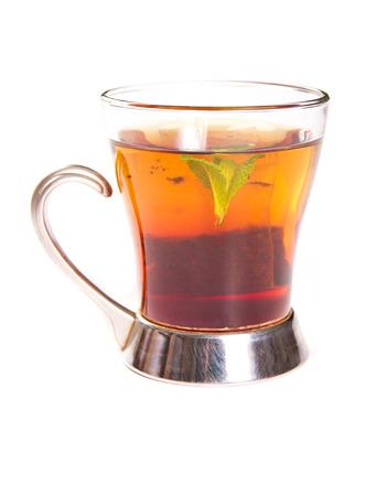 Tea in a trasparent cup photo