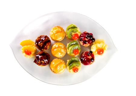 Mini tartes with fruit and vanilla cream photo