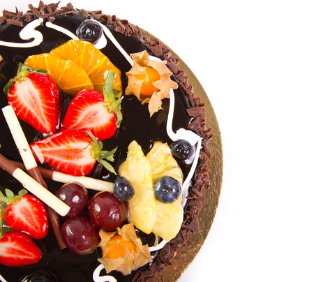 Chocolate cake with fresh fruit decoration photo