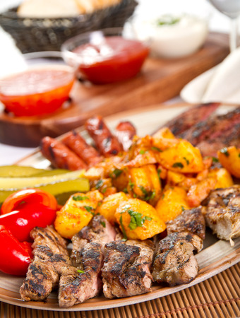 Mixed grilled meat platter and pickles photo