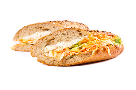 Sandwich with meat and vegetables on white photo