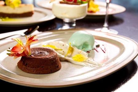 Molten lava cake with vanilla and mint icecream photo
