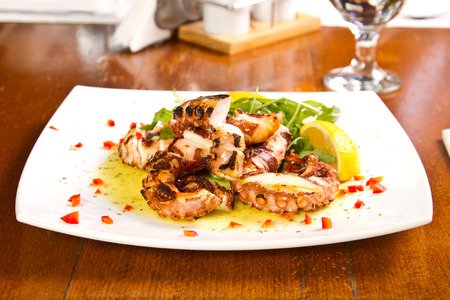Grilled octopus with lemon juice photo