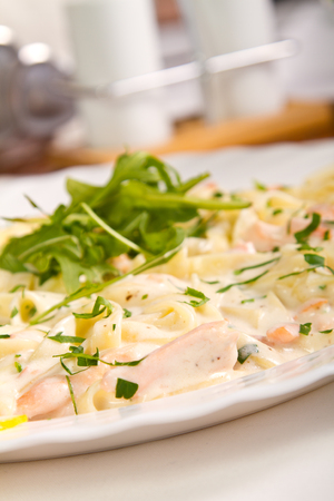 Salmon fettucine with white sauce photo