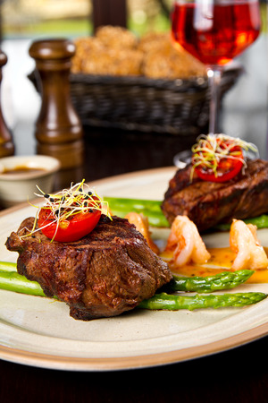 Beef steak and shrimp with grilled vegetables photo