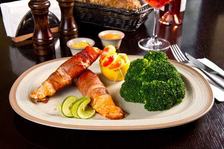 Bacon wrapped salmon with broccoli photo