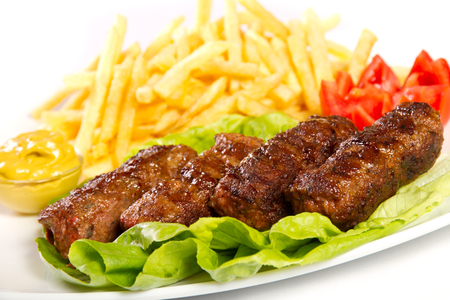 cooked pepper ball: Turkish meatballs with fries and mustard Stock Photo