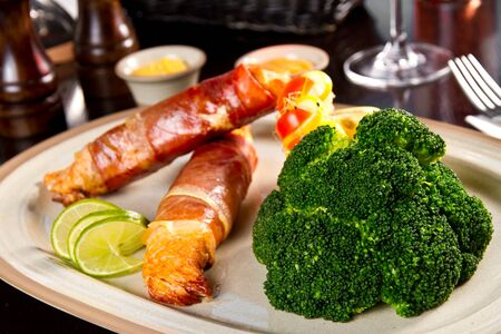 broccolli: Bacon wrapped salmon with broccoli Stock Photo