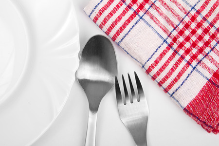 Alluminum silverware next to a plate