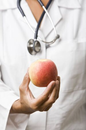 nutrition doctor: doctor holding an apple