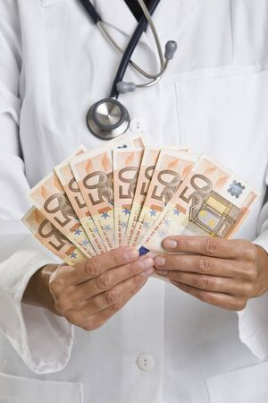 female doctor holding money photo