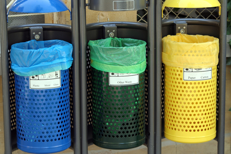 reusing: Recycle bins for paper,glass,metal,plastic