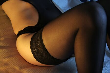 black stockings: Woman wearing sexy lingerie on the bed