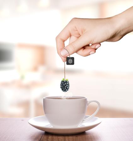 Blackberry tea in a plain white cup | Fruit Tea Фото со стока