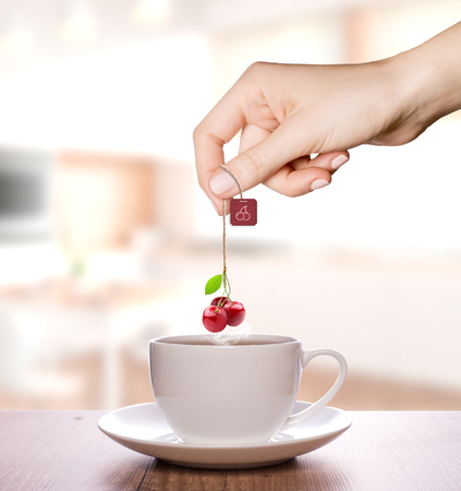 Cherry tea in a plain white cup | Fruit Tea Фото со стока