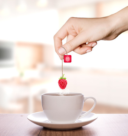 Raspberry tea in a plain white cup | Fruit Tea Фото со стока