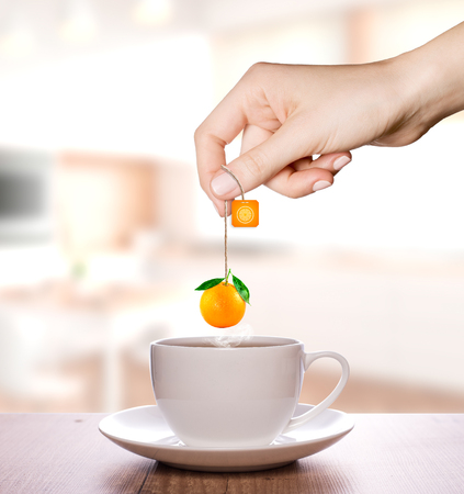 Orange tea in a plain white cup | Fruit Tea