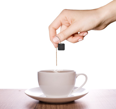 Tea in a plain white cup and white background Stock Photo
