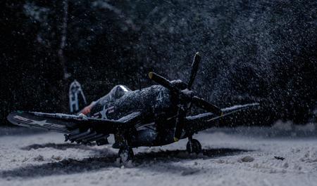 World war II military aircraft with heavy snowfall
