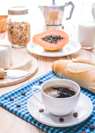 Traditional and healthy breakfast with black coffee Фото со стока