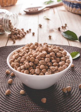 Chickpeas in a white bowl Фото со стока