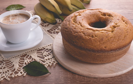 Traditional banana cake and a cup of milk with coffee | Grandmother cake