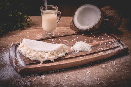 Coconut tapioca with condensed milk | Cassava flour pan, condensed milk and coconut - Typical northeastern Brazilian food