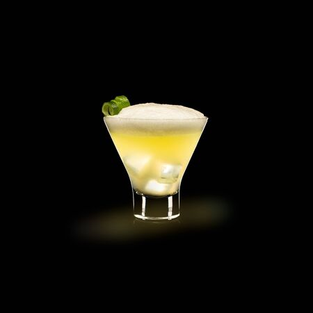 Pisco Sour - Popular Drink on a black background 免版税图像