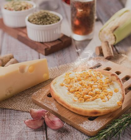 Traditional Arabic esfiha of corn and open cheese