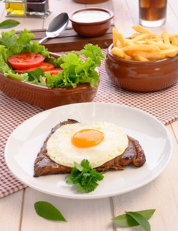 horse steak - Brazilian traditional food - Steaks, White rice, farofa and salad