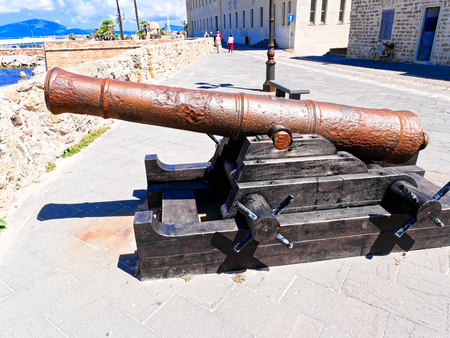View of the cannon and promenade in the background in the city of Alghero. Sardinia. Imagens