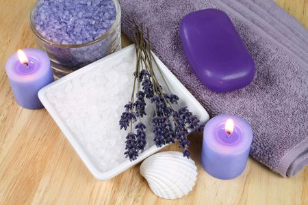 Spa resort therapy composition - lavender flowers, candle and salt crystals photo