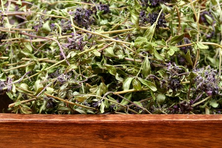 A wooden bowl of dried herbs - Thymus serpyllum Stock Photo - 6918794