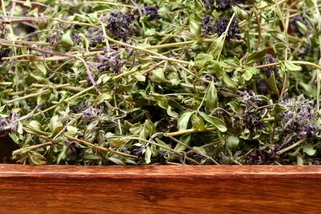 A wooden bowl of dried herbs - Thymus serpyllum Stock Photo - 6918794