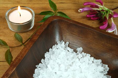 Spa resort therapy composition, candle, flower and salt crystals photo