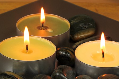 Three aromatherapy candles and spa stones Stock Photo - 6918850