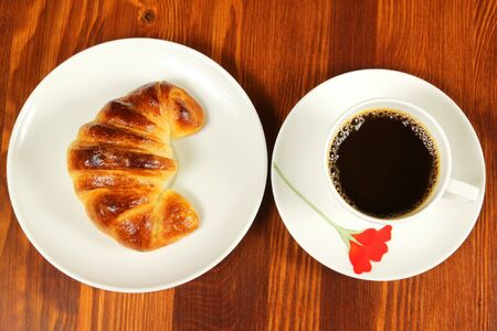 Breakfast with cup of coffee and croissant photo