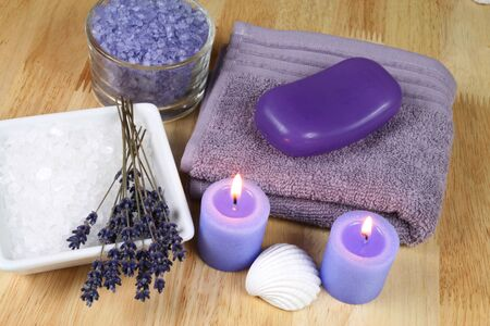 Spa resort therapy composition - lavender flowers, candles and salt crystals. Afternoon relax photo