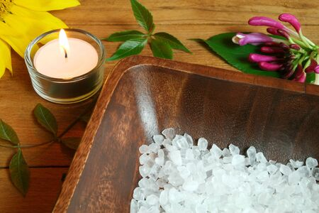 Spa resort therapy composition, candle, flowers and salt crystals photo