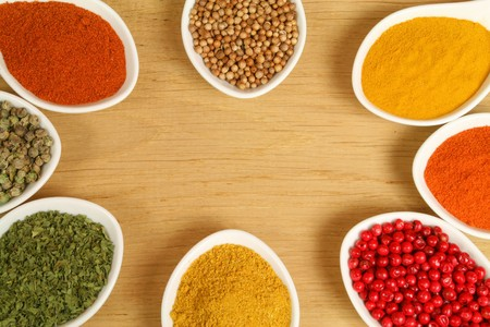 Colorful frame of different spices in polcelain containers photo
