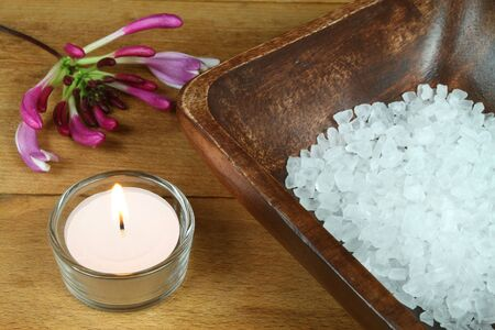 Honeysuckle flower and salt crystals in spa treatment photo