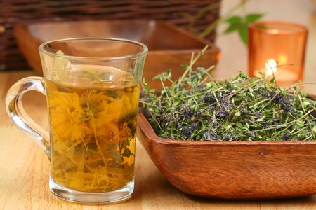 precipitate: Glass of different infused herbs and bowl with dried thyme