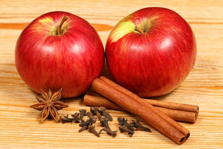 cider: Apples and spices - two juicy fruits on the wooden table Stock Photo