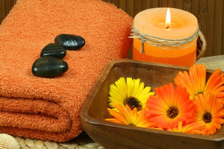 colorful wellness and spa therapy with beautiful marigold flowers. photo